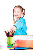 Adorable little girl drawing in a sketchbook with colored pencils Royalty Free Stock Photos