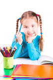 Adorable little girl drawing in a sketchbook with colored pencils Stock Photo