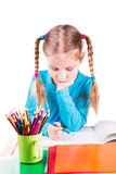 Adorable little girl drawing in a sketchbook with colored pencils Stock Photography