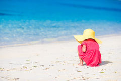 Adorable little girl drawing on white sand at the Stock Images