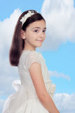Adorable little girl dressed in communion Stock Photography