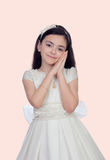 Adorable little girl dressed in communion Stock Images