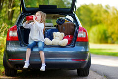 Adorable little girl drinkig water in a car Royalty Free Stock Photos