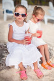 Adorable little girl drinking fresh watermelon on Stock Image