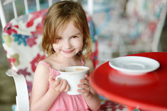 Adorable little girl drinking hot chocolate Royalty Free Stock Photos