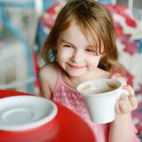 Adorable little girl drinking hot chocolate Royalty Free Stock Image