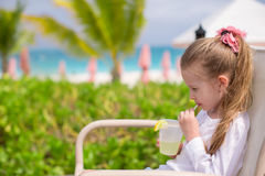 Adorable little girl drinking juice at outdoor Royalty Free Stock Photo