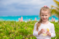 Adorable little girl drinking juice at outdoor Stock Photography