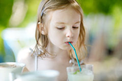 Adorable little girl drinking lemonade Royalty Free Stock Photography