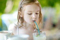 Adorable little girl drinking lemonade Royalty Free Stock Photography