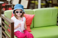 Adorable little girl drinking milkshake Royalty Free Stock Photography