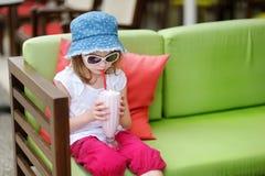 Adorable little girl drinking milkshake Royalty Free Stock Image