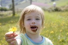 Adorable little girl eating chocolate Stock Photography