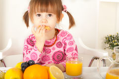 Adorable little girl eating cookie Stock Photos