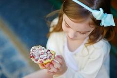 Adorable little girl eating fresh strawberry cake Royalty Free Stock Photography