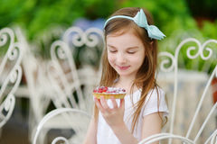 Adorable little girl eating fresh strawberry cake Royalty Free Stock Images