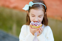 Adorable little girl eating fresh strawberry cake Stock Photo