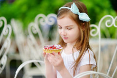 Adorable little girl eating fresh strawberry cake Royalty Free Stock Photo