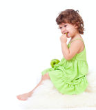 Adorable little girl eating green apple Stock Photo