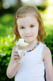 Adorable little girl eating ice-cream Royalty Free Stock Photography