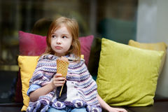 Adorable little girl eating ice cream Stock Photography