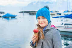 Adorable little girl eating ice cream Royalty Free Stock Images