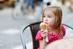 Adorable little girl eating ice-cream outdoors Royalty Free Stock Photo