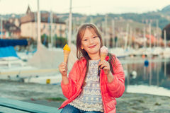 Adorable little girl eating ice cream outdoors Stock Images