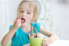 Adorable little girl eating ice cream Stock Photo