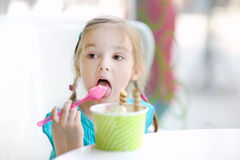 Adorable little girl eating ice cream Stock Images