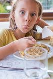 Adorable little girl eating spaghetti in outdoors Royalty Free Stock Photos