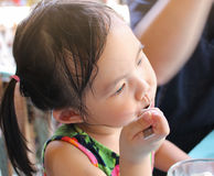 Adorable little girl enjoy eating ice cream. Royalty Free Stock Photography