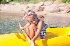 Adorable little girl enjoy kayaking during summer Stock Photography