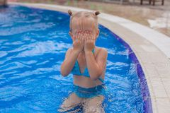 Adorable little girl enjoy in the swimming pool Stock Photos