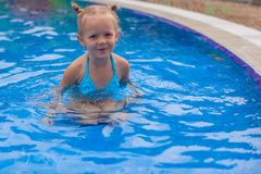 Adorable little girl enjoy in the swimming pool Royalty Free Stock Photos