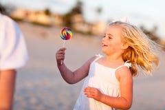 Adorable Little Girl Enjoying Her Lollipop Outside stock image