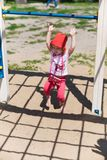 Adorable little girl enjoying her time in climbing adventure park on warm and sunny summer day. Summer activities for young kids. Stock Photography