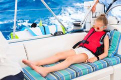 Little girl at luxury yacht. Adorable little girl enjoying sailing on a luxury catamaran or yacht royalty free stock photo