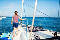 Little girl at luxury yacht. Adorable little girl enjoying sailing on a luxury catamaran or yacht stock images