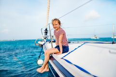 Little girl at luxury yacht. Adorable little girl enjoying sailing on a luxury catamaran or yacht stock photos