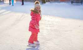 Adorable little girl enjoying skating at the Stock Image