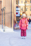 Adorable little girl enjoying skating at the Stock Photo