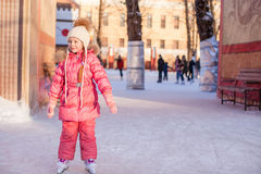 Adorable little girl enjoying skating at the Royalty Free Stock Photos