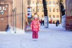 Adorable little girl enjoying skating at the Stock Photography