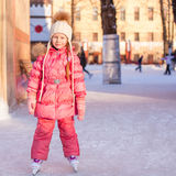 Adorable little girl enjoying skating at the Royalty Free Stock Image