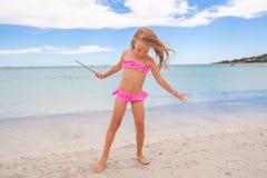 Adorable little girl enjoying tropical beach Royalty Free Stock Image
