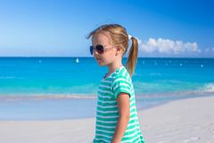 Adorable little girl enjoying vacations on the beach Royalty Free Stock Photo
