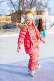 Adorable little girl enjoys skating at the Stock Image
