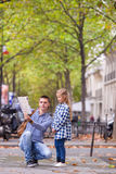 Adorable little girl and father with map of Royalty Free Stock Images