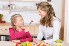 Adorable little girl feeding her mother Stock Photos